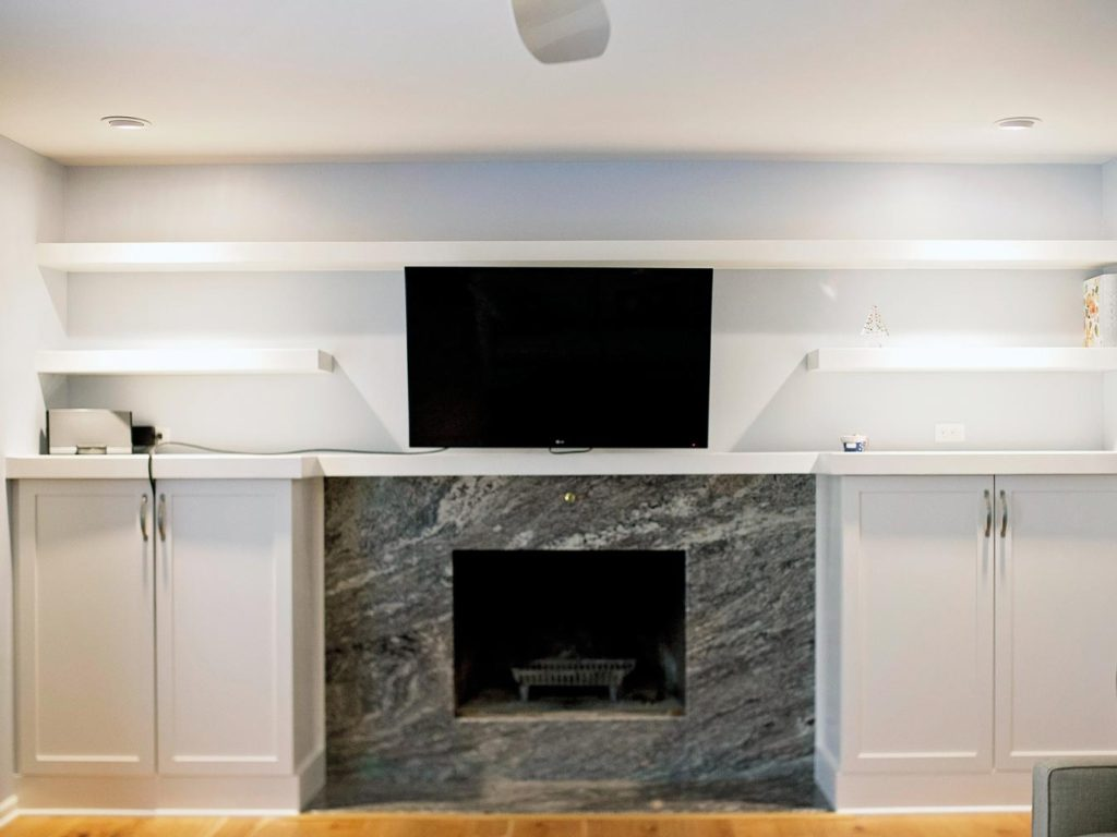 Cheramy Builders Inc., Family Room Entertainment Center and fireplace with marble hearth