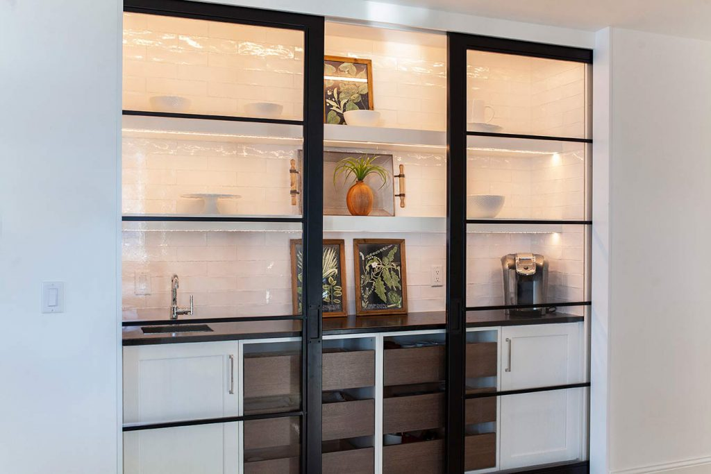 Cheramy Builders Inc., custom built-in cabinets and shelving with custom glass pocket doors